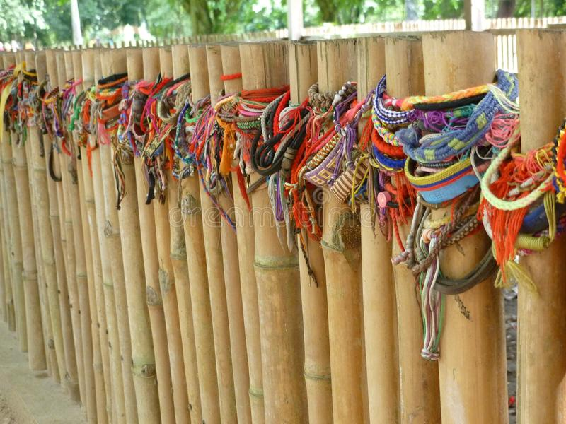 Bracelets Left on the Fence Surrounding Mass Graves at the Killing Fields stock photos