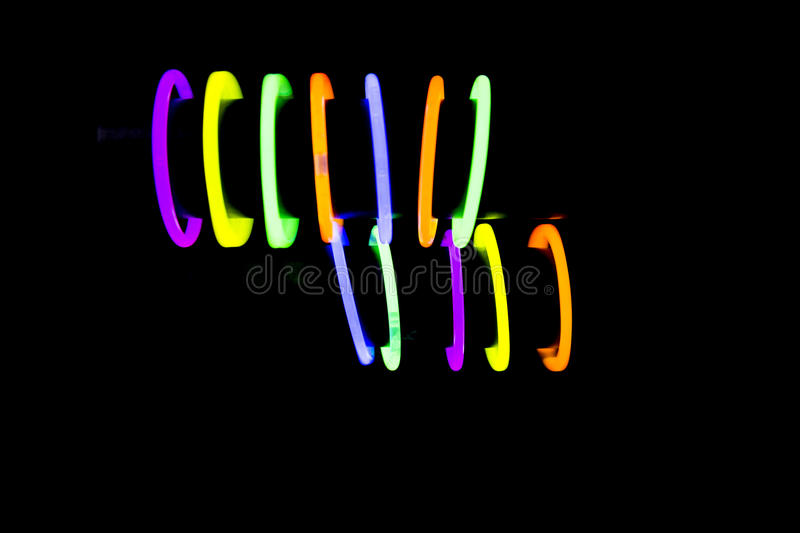 Bracelets made with glow sticks fluorescent lights. Bracelet jewel made with glow sticks neon light fluorescent on back background. Nightclub cocktail bar stock images