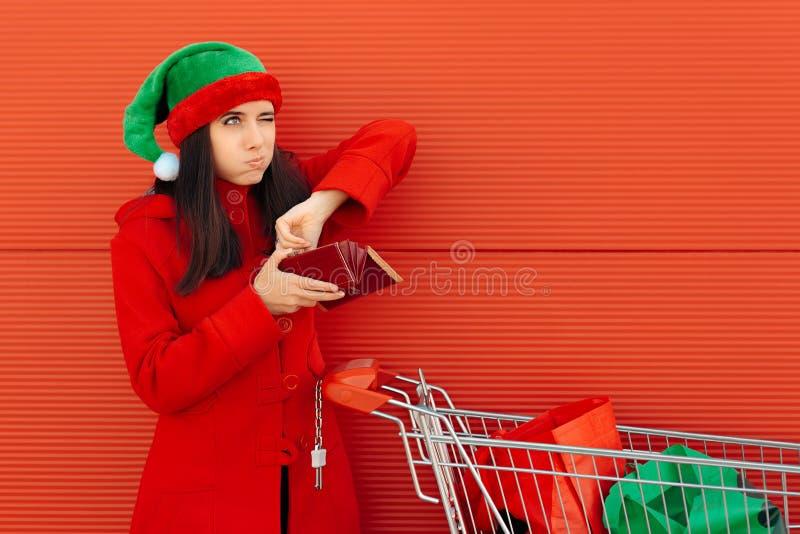 Brach die Frau, die ihre letzten Dollar für das Weihnachtseinkaufen ausgibt stockfotos