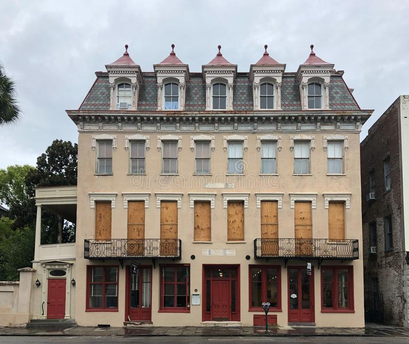 Bracing for Hurricane Dorian. Historic buildings in downtown Charleston, South Carolina are boarded up to protect them from Hurricane Dorian stock images