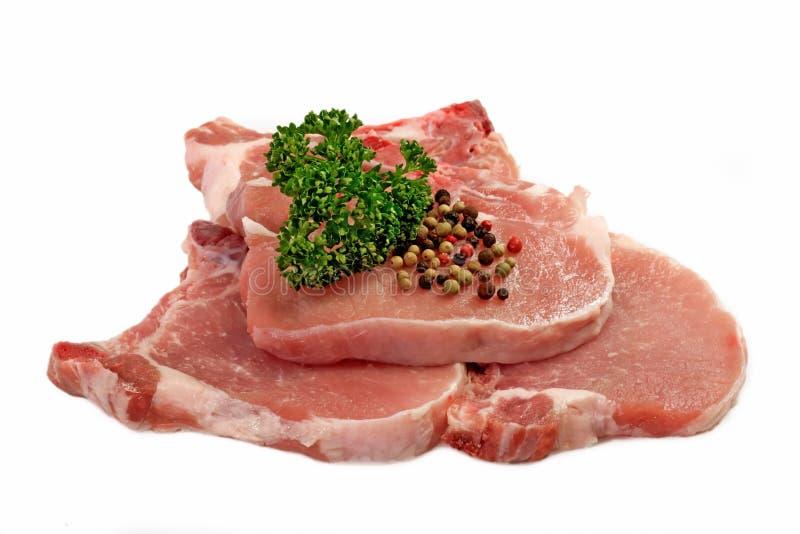 Braciole di maiale grezze immagini stock libere da diritti