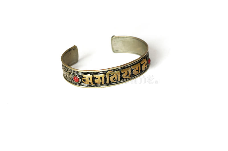 Braclet with a mantra royalty free stock photos