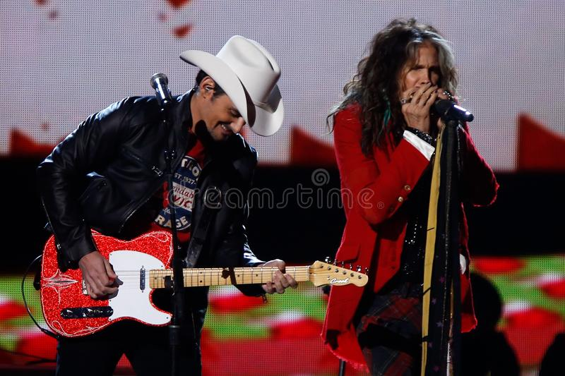 Brad Paisley, Steven Tyler. NASHVILLE, TN-NOV 7: Recording artists Brad Paisley L and Steven Tyler of Aerosmith perform at the 2014 CMA Country Christmas at the royalty free stock images