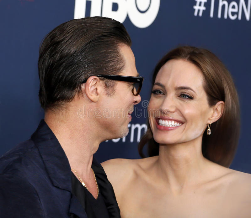 """Brad Pitt and Angelina Jolie. Actor Brad Pitt and wife, actress Angelina Jolie, arrive on the red carpet for the New York premiere of """"The Normal Heart stock image"""