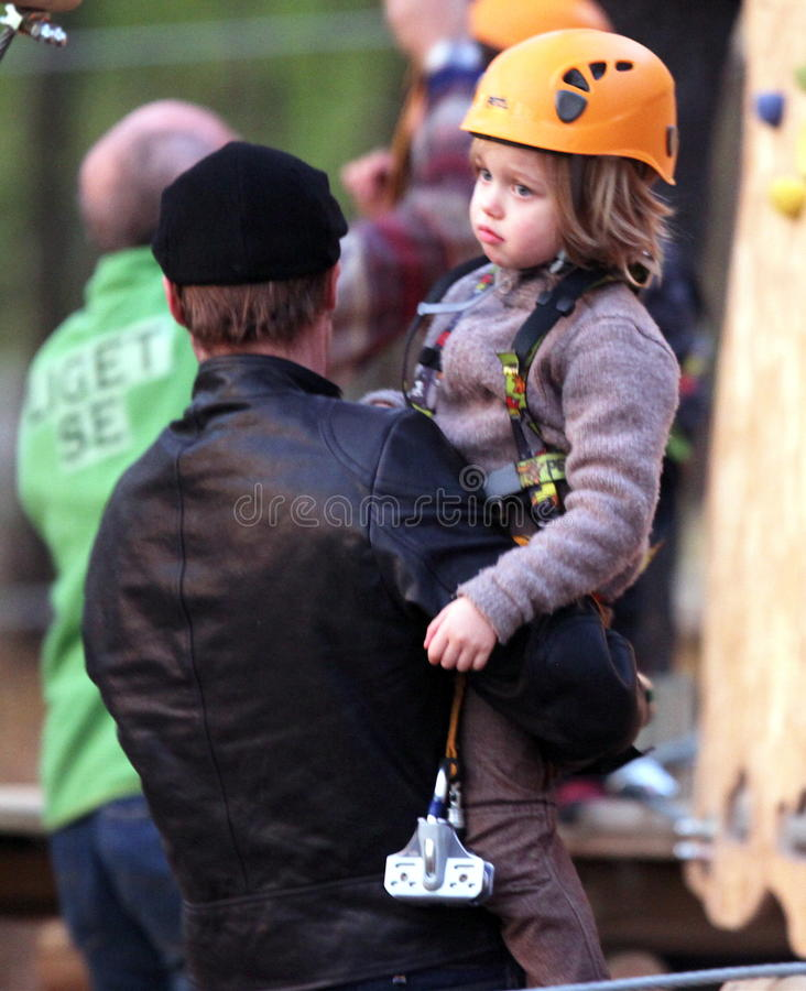 Brad Pitt and Angelina Jolie. Take their children Pax, Zahara and Shilo to a park in Budapest, Hungary, on Friday. Jolie is in Hungary filming her directorial royalty free stock photo