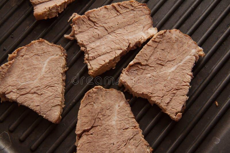 Bradende Lapjes vlees stock afbeeldingen
