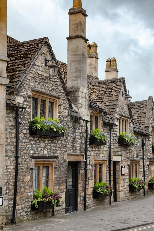Bradford-on-Avon architecture Wiltshire Southwest England UK. Old slate roof stone houses decorated with flowers in Bradford on Avon, a town and civil parish in royalty free stock photos