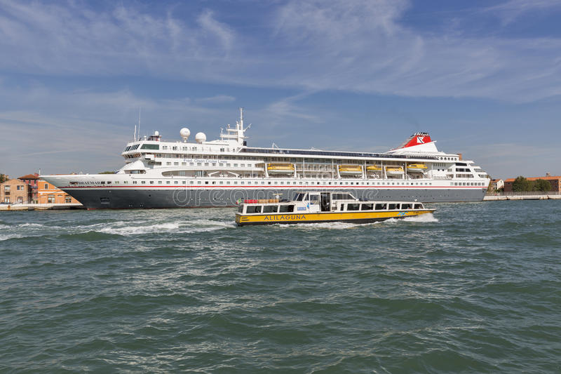 Braemar cruise ship and water bus in Venice lagoon, Italy. stock photo
