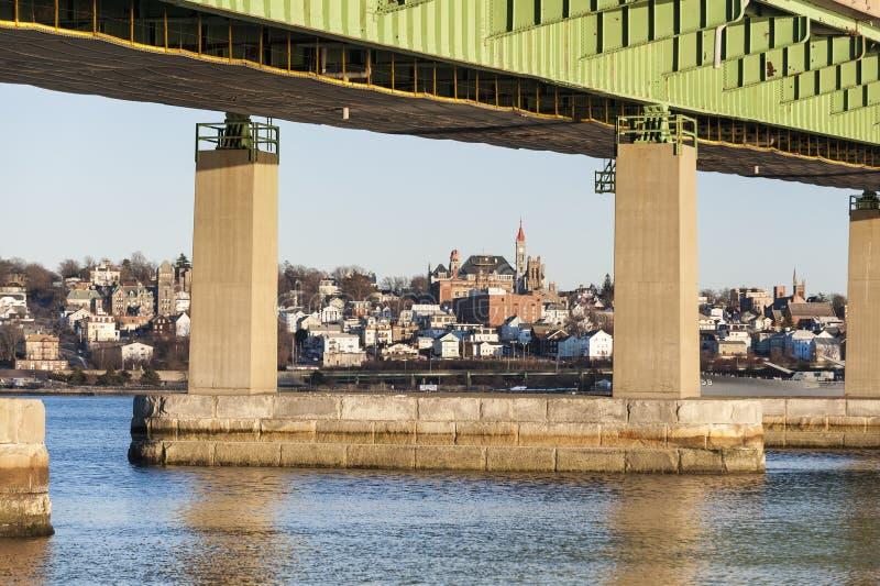 Braga Bridge framing Fall River skyline. Braga Bridge framing Fall River hillside overlooking Taunton River stock image