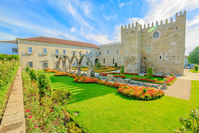 Braga Episcopal Palace. Braga, Portugal. A side of architectural complex of medieval Episcopal Palace of Braga or Paco Episcopal Bracarense in town hall square stock images