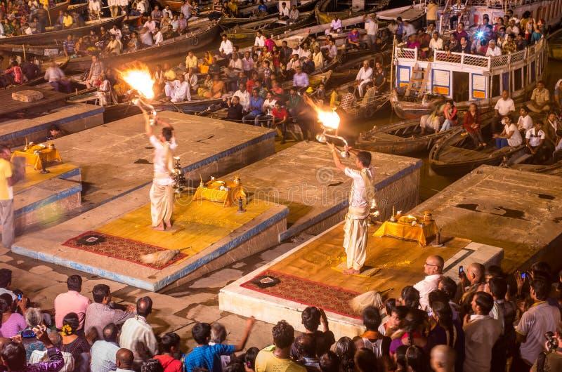 Brahmin priests perform a Puja ceremony to the sacred river Gan. VARANASI, INDIA - SEP 04 2014 - Brahmin priests perform a Puja ceremony to the sacred river stock images