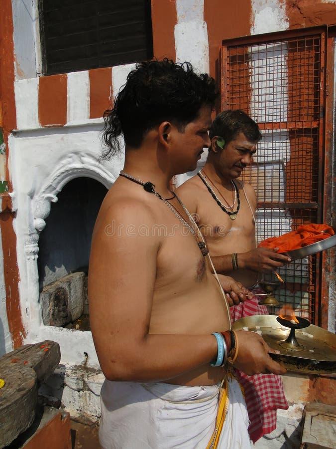 Brahmin priests of Shiva. VARANASI, INDIA - NOV 7 - Brahmin priests of Shiva prepare sacred fire for ceremonies outside their temple on Nov 7, 2009, in Varanasi royalty free stock photos