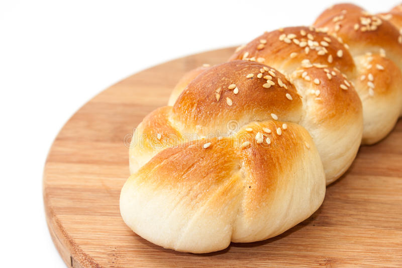 Braid from the bakery on a kitchen wooden board.  royalty free stock photo