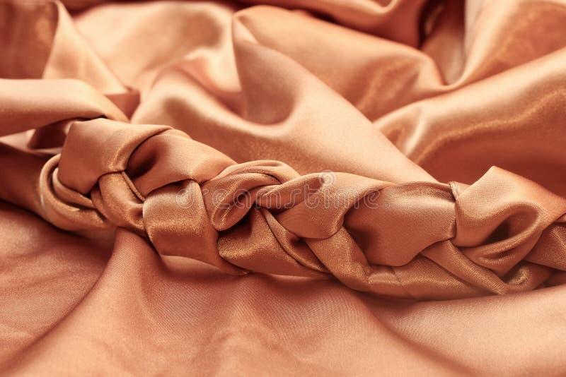 Braid woven silk gold fabric chocolate. Brown stock photos