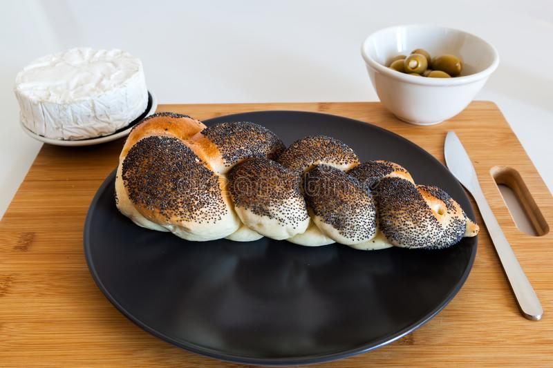 Braided bread with olives and cheese stock photography