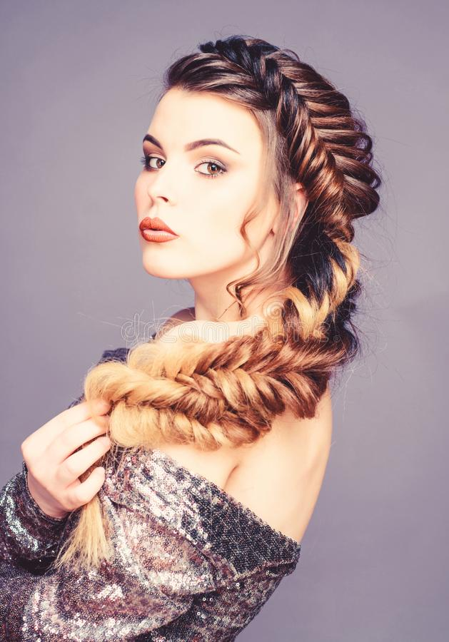 Braided hairstyle. Beautiful young woman with modern hairstyle. Beauty salon hairdresser art. Girl makeup face braided royalty free stock image