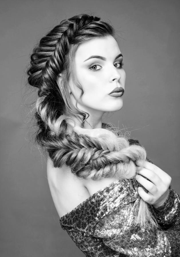Braided hairstyle. Beautiful young woman with modern hairstyle. Beauty salon hairdresser art. Girl makeup face braided stock image