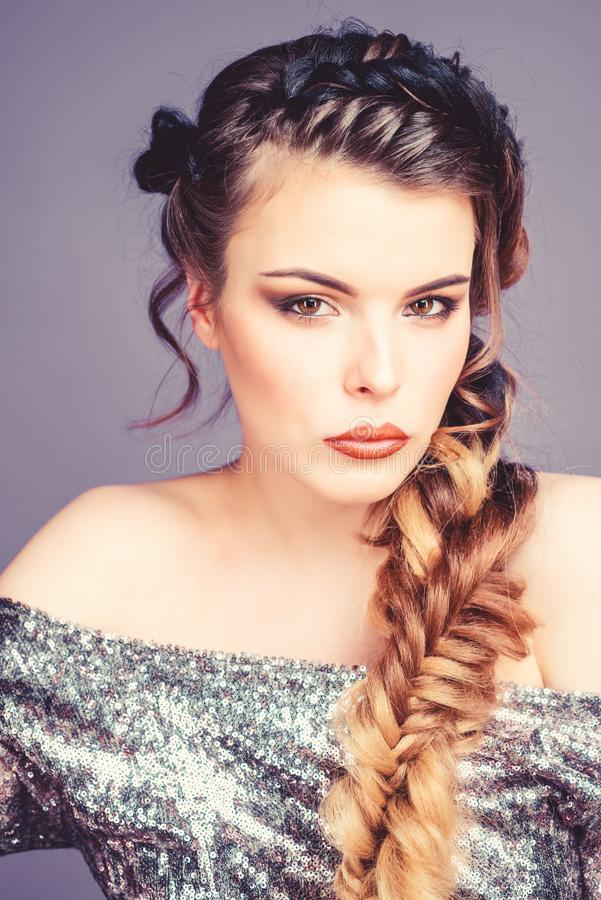 Braided hairstyle. Beautiful young woman with modern hairstyle. Girl makeup face braided long hair. French braid. Professional hair care and creating hairstyle stock image