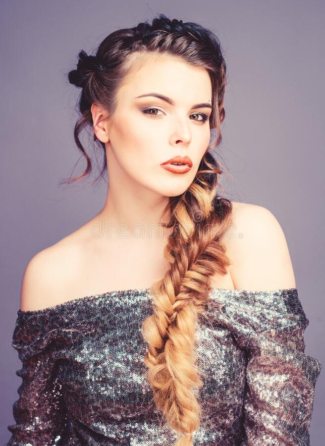 Braided hairstyle. French braid. Professional hair care and creating hairstyle. Beauty salon hairdresser art. Beautiful. Young woman with modern hairstyle. Girl royalty free stock photo