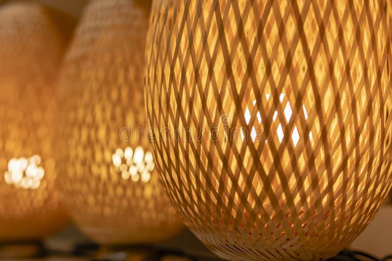 Braided orange light from the tree with a burning lamp inside stock photos