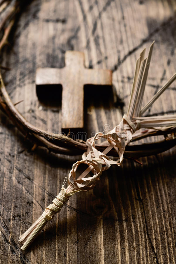 Braided palm, cross and crown of thorns stock photo
