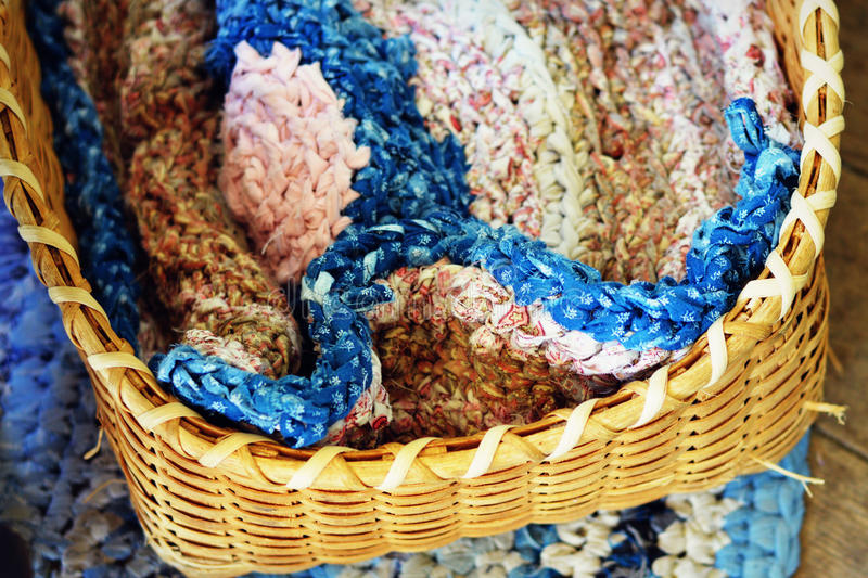 Braided Rug in Basket stock photography