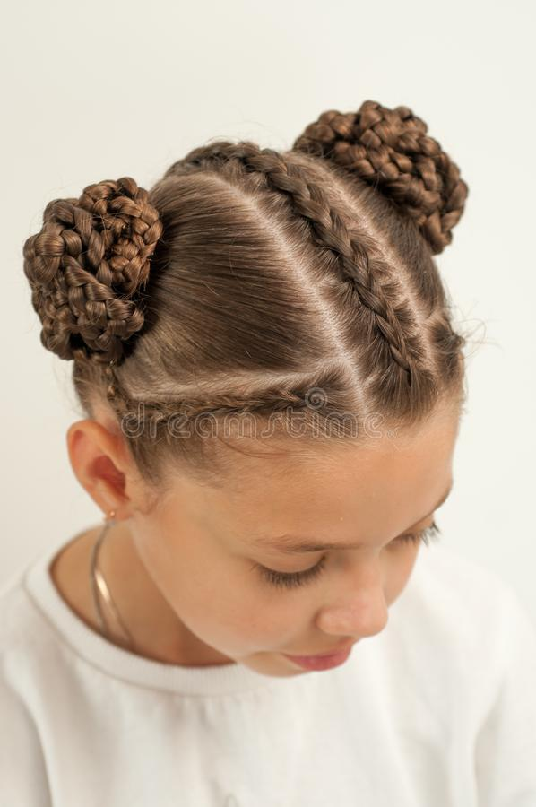 Braids on a girl. Beautiful hair weave on a girl with dark hair royalty free stock photos