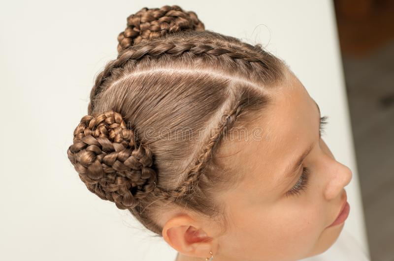 Braids on a girl. Beautiful hair weave on a girl with dark hair royalty free stock images