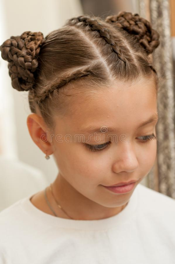 Braids on a girl. Beautiful hair weave on a girl with dark hair stock images
