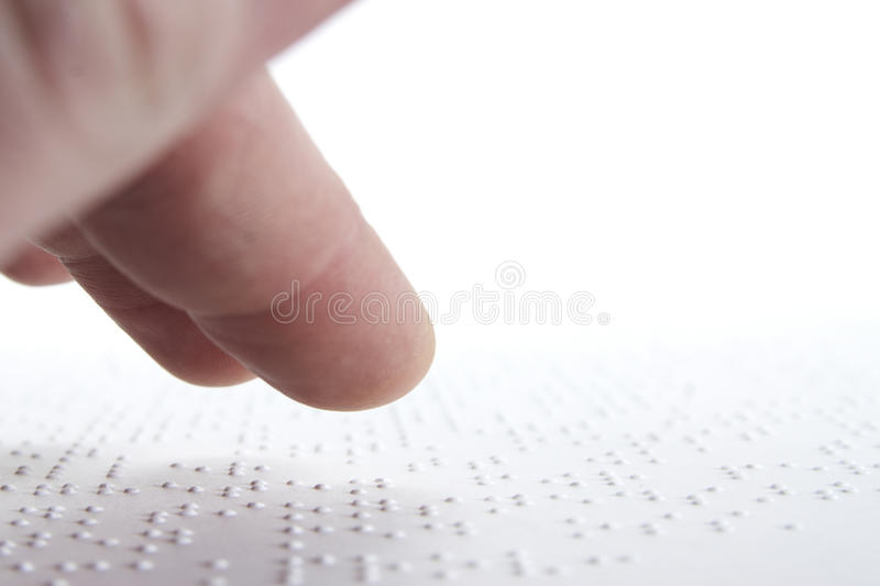 Braille. Person reading braille in swedish royalty free stock image