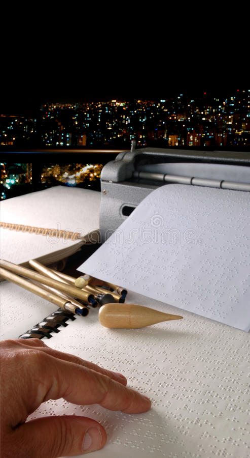 Braille. Blind student with books in braille and braille typewriter in stock photography