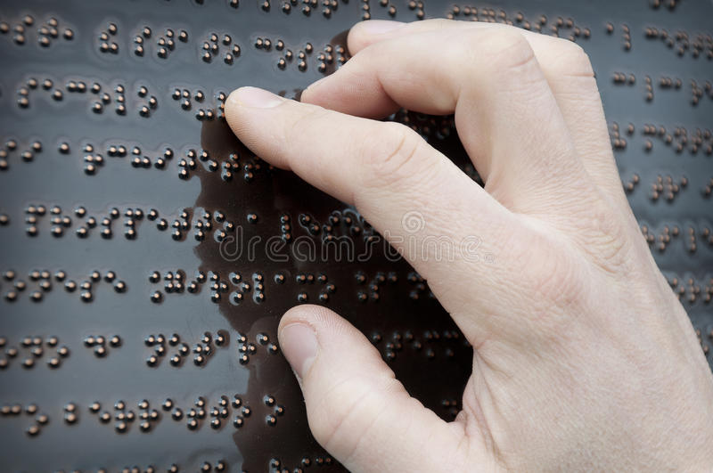 Braille tactile font. Part of the text on Braille tactile font royalty free stock photo