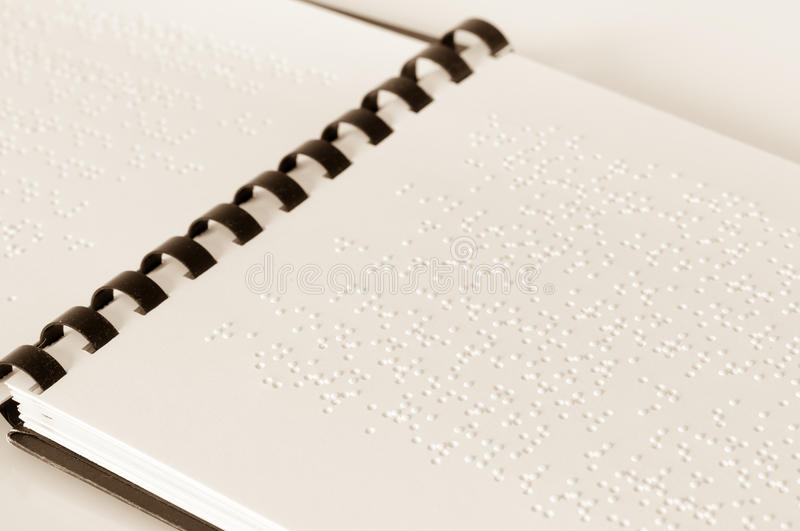 Braille text. Book for blind people printed in Braille royalty free stock image