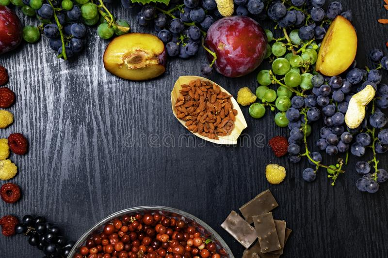 Brain boosting health food background border with fruits, nuts,berry. Foods high in vitamin C, vitamins, minerals, antioxidants an royalty free stock photography