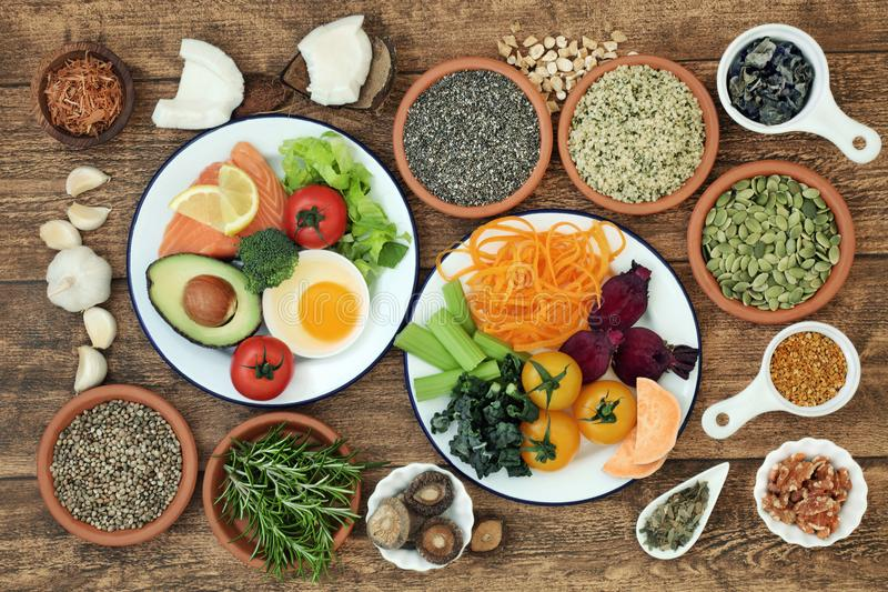 Brain Boosting Healthy Super Food. Concept with fish, dairy, vegetables, seeds, pollen grain, nuts and herbs. Foods high in omega 3, vitamins, minerals stock image