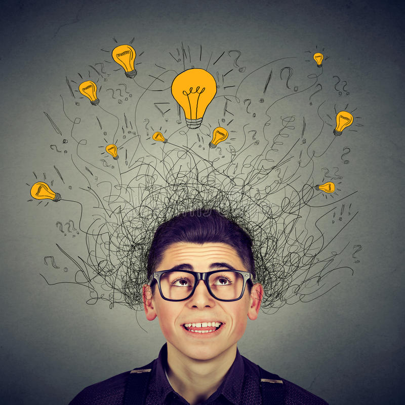 Brain connections. Man with many ideas light bulbs above head. Brain connections. Excited man with many ideas light bulbs above head looking up isolated on gray royalty free stock image