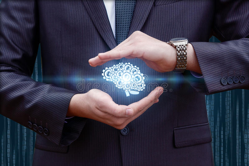 The brain consists of gears in the hands. royalty free stock photography