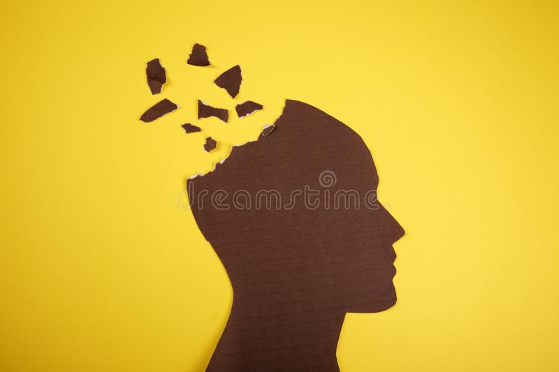 Brain disorder symbol presented by human head made form paper . Creative idea for Alzheimer`s disease, dementia, memory. Loss and mental health concept stock image