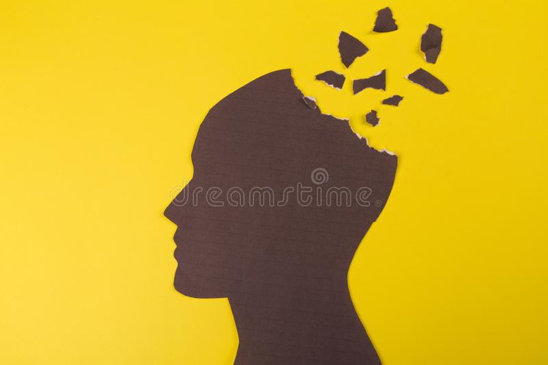 Brain disorder symbol presented by human head made form paper . Creative idea for Alzheimer`s disease, dementia, memory stock illustration