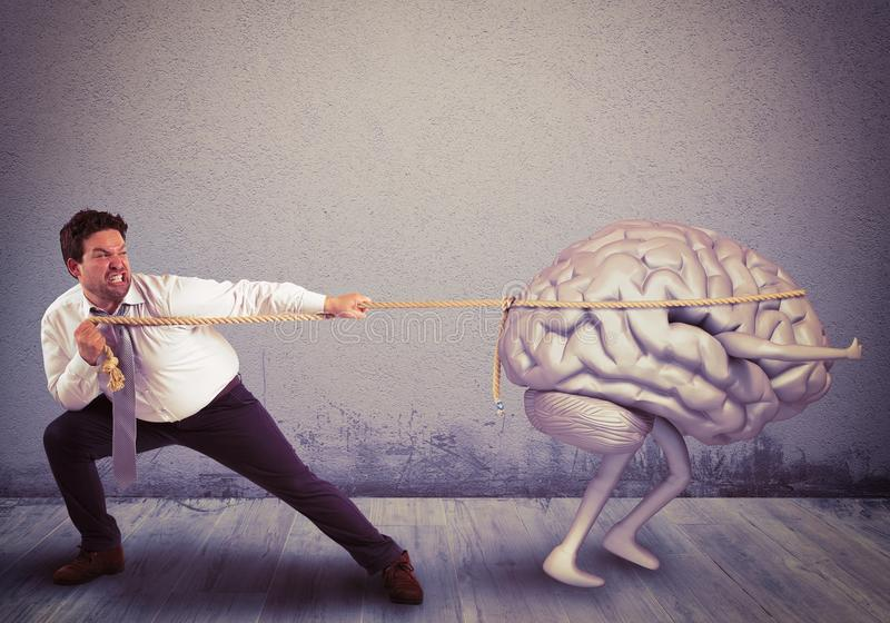Brain drain. Man pulls the rope with brain drain royalty free stock photo