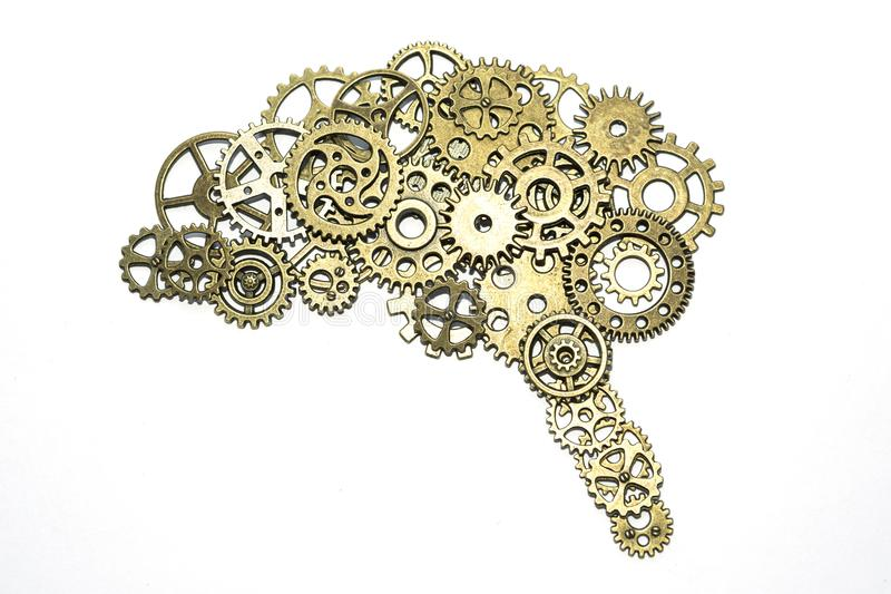 Brain of golden gears on a white background. assembled from the details of the puzzle. royalty free stock photos