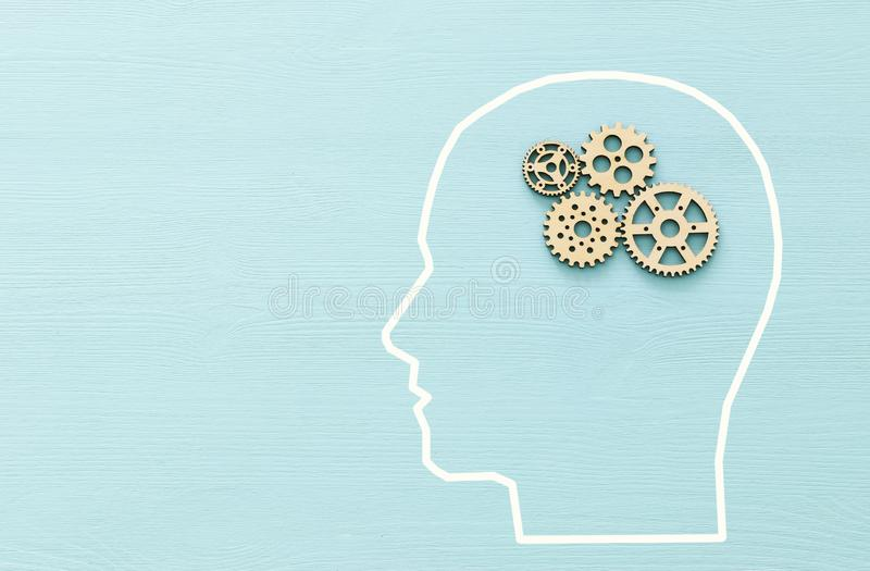 Brain order made from wooden cogwheels into human head. Concept of thinking, workflow, adhd and learning. stock photos
