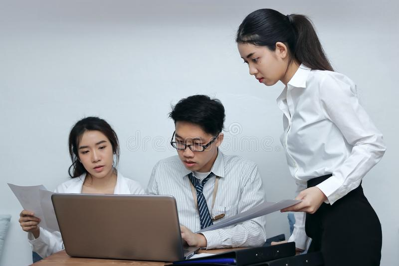Brainstorm business concept. Confident young Asian employee working together on workplace in office stock photos