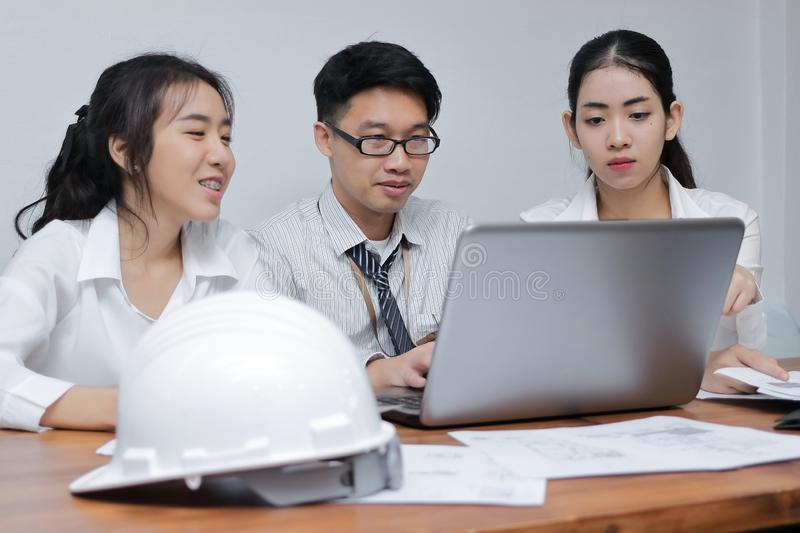 Brainstorm business concept. Confident young Asian employee working together on workplace in office stock image