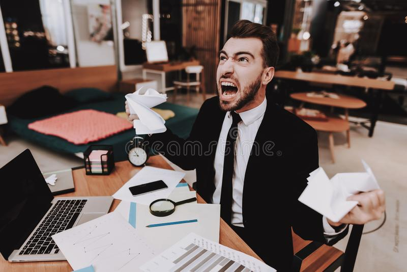 Brainstorm. Upset. Large Amount of Work. Office. Brainstorm Upset Large Amount of Work Business Suit Workplace Ideas Project Laptop. Sit Young Guy Businessman stock photography