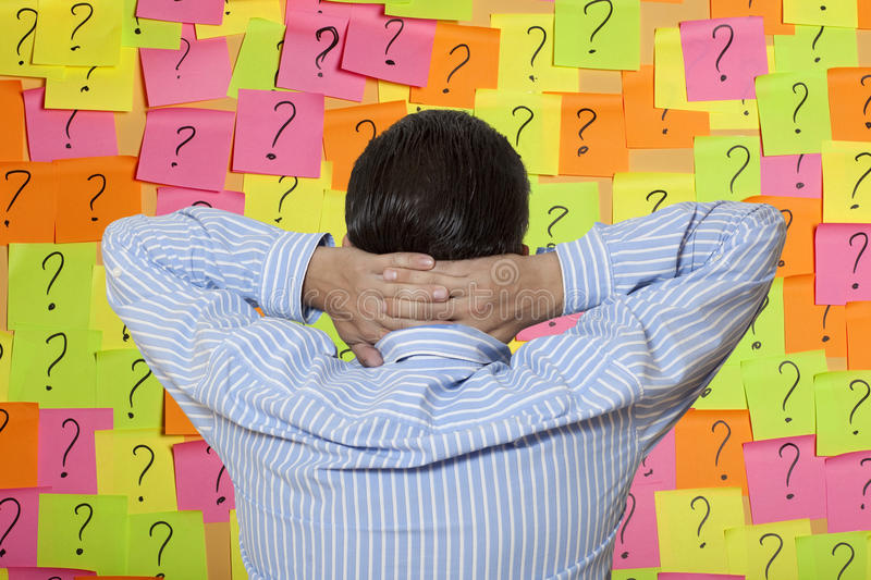 Brainstorming. The man costs opposite to a brick wall royalty free stock photo