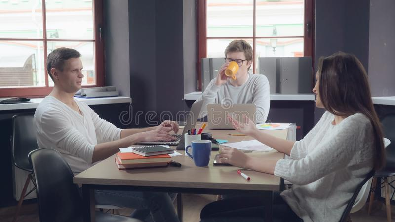Business team sitting at the working place. stock photography