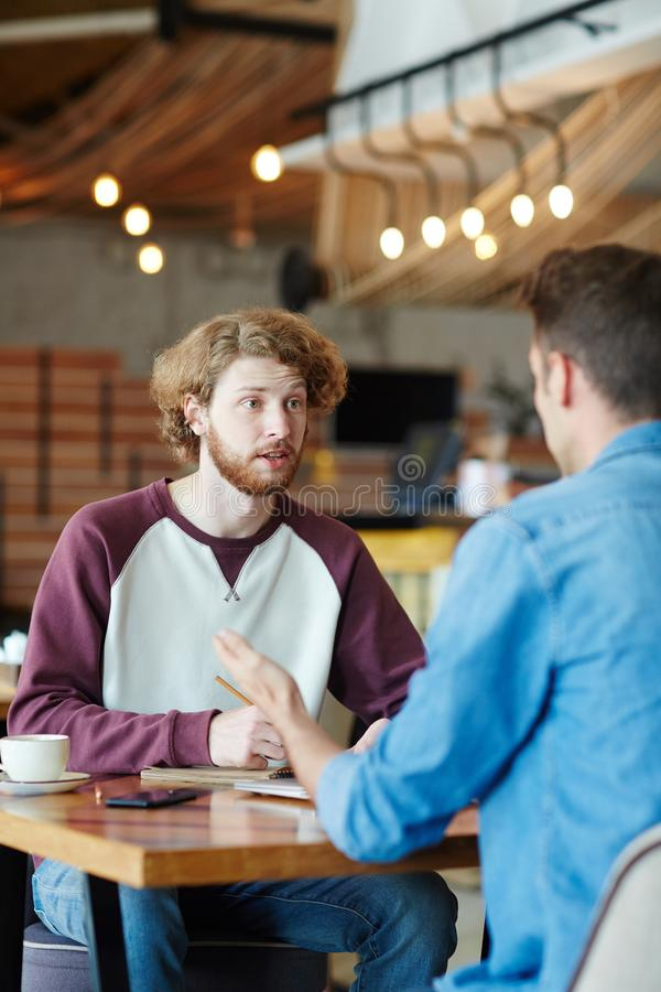 Brainstorming at Cozy Coffeehouse stock image