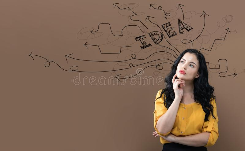 Brainstorming idea arrows with young businesswoman royalty free stock images