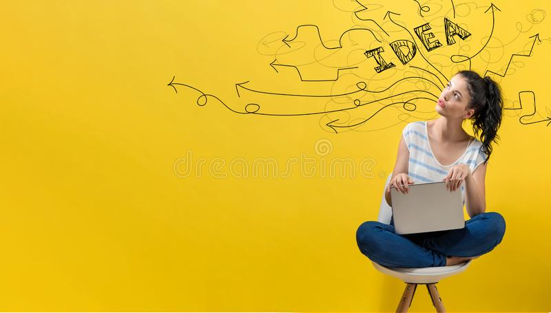 Brainstorming idea arrows with woman using a laptop stock images